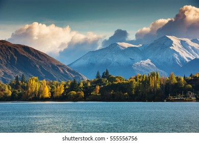 First snow in Wanaka, south island, New Zealand with colorful tree, mountain and lake.