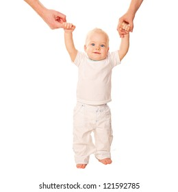 First steps. Baby learning to walk, with help of mothers and fathers hands. White T-shirt is ready for your logo or text. Isolated on white background