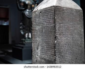 "The first stone inscription or King Ramkhamhaeng Inscription, showing ""Laisue Thai"" the origin of Thai alphabet. Exhibited in Bangkok National Museum, Thailand. Shot on 13jun19."