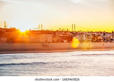 The first sun rays behind the hermosa beach, Los angeles