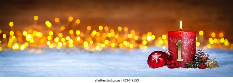 first sunday in advent concept xmas light wooden wide panorama background with candles ball bauble stars