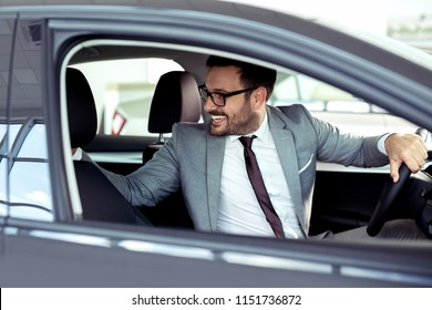 First test drive a new car. Businessman ready to make first test drive