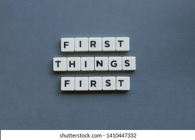 ' First Things First ' word made of square letter word on grey background.