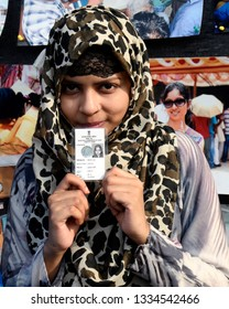 First time voter Zeenat Ara show her voter card after receiving it on the occasion of National Voter's day on January 25, 2019 in Calcutta, India.