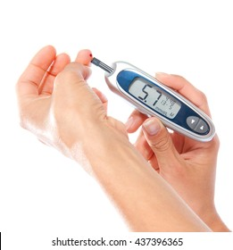 First type Diabetes patient measuring glucose level blood test use glucometer and small drop of blood from finger and test strips isolated on a white background