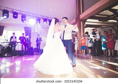 First wedding dance of newlywed couple in restaurant