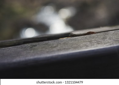 The first winter frost is already on the railing. Close-up. In the forest background. Winter is knocking on the door. Cold weather. Period of illness and increased number of injuries.