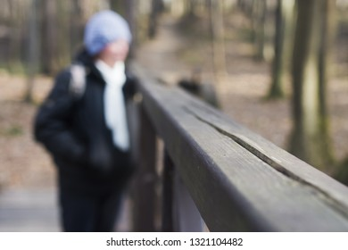 The first winter frost is already on the railing. Close-up. In the forest background. People. Winter is knocking on the door. Cold weather. Period of illness and increased number of injuries.