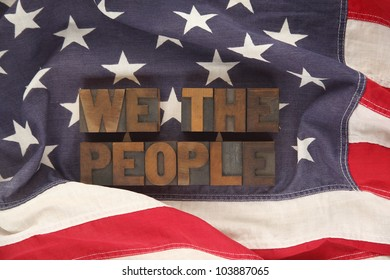 first words of the Preamble to the Constitution on an old flag