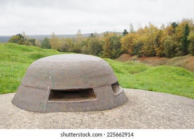 A First World War observation post on Fort Douaumont, Verdun. Uneven ground beyond is the result of constant shelling one hundred years ago.
