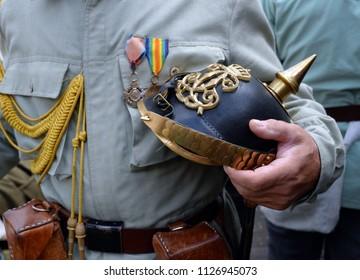 first World War soldier holding a spiked helmet