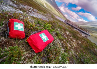 Firstaid kits on the grass.