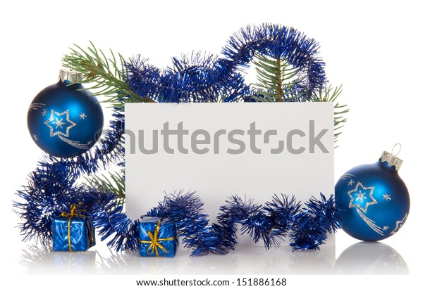 Fir-tree branch with tinsel, small gift boxes, two Christmas toy and a card isolated on white