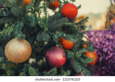 Fir-tree spruce with christmas decor toys. Holiday background. Copy space. Vintage effect.