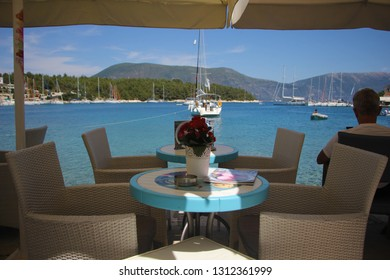 Fiscardo, Kefalonia, Greece - June, 3: Seaside restaurant with chairs and tables. Outdoor restaurant. June, 3 2015