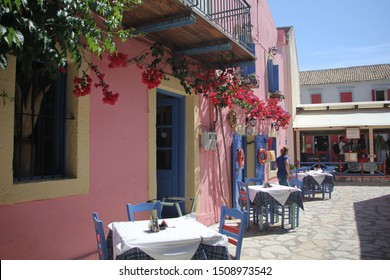 Fiscardo, Kefalonia, Greece - June, 3: Beautiful restaurant in Fiscardo. Greek restaurant, exterior, chairs, tables. Empty wooden blue tables and chairs. June, 3 2015