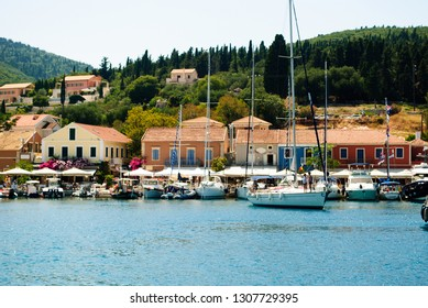 Fiscardo, a village in the Ionian island of Kefalonia, Greece with colorful houses and Ionian architecture.