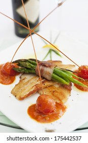 Fish, bacon and vegetable. Delicious food arranged on a plate.