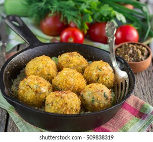 Fish balls. Homemade fish cakes with a sauce of leek. Selective  focus