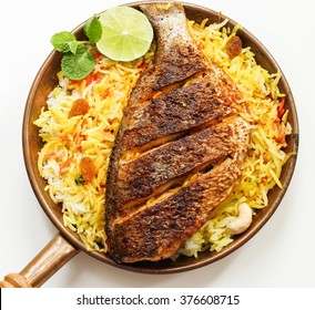 Fish Biryani top down view, isolated on white