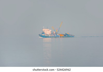Fish boat floating in the fog. No horizon