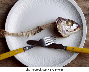 Fish bone with fork and knife in a beautiful plate