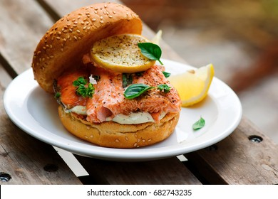 Fish burger with herb and lemon sauce.selective focus