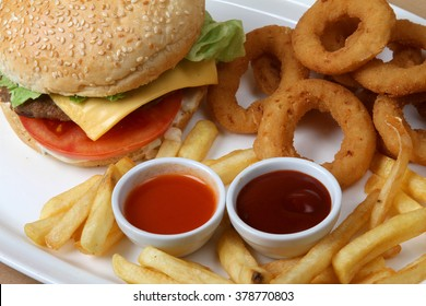 fish burger with onion rings and French fries  - American food - fast food - junk food