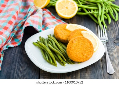 Fish burgers served with green bean sprouts