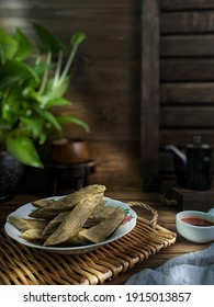 Fish Cake known as Keropok Lekor,famous traditonal food in Malaysia with sauce and coffee .