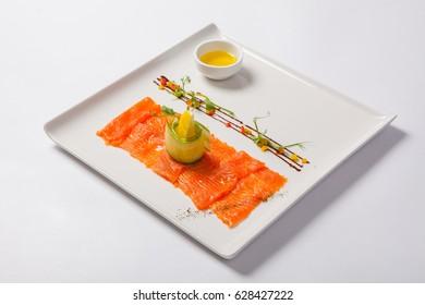 Fish carpaccio. Carpaccio of salmon on white plate.