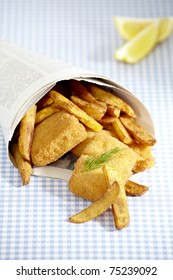 Fish and chips into newsprint