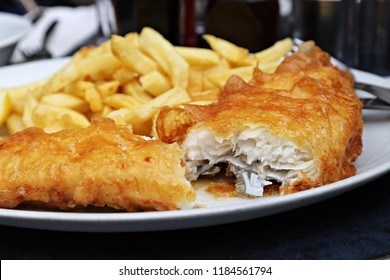 Fish and Chips on a white plate, shallow focus