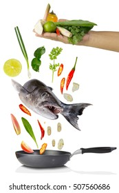 Fish cooking with spicy herbs set,Tomyum making on white background,vegetables eating