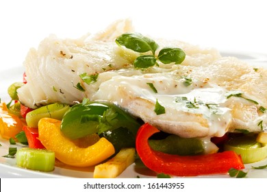 Fish dish - boiled fish fillet with vegetables