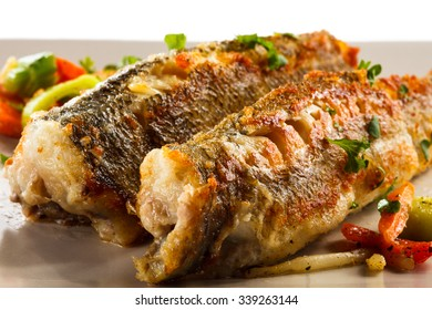 Fish dish - fried fish and vegetable salad