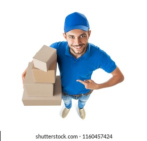 Fish eye shot of delivery man shows on boxes in his hand isolated on white background