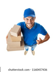 Fish eye shot of delivery man Funny courier with boxes looking at camera isolated on white background, top view, fish eye lens shot