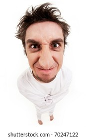 Fish eye shot of screaming insane man in strait-jacket on grey background