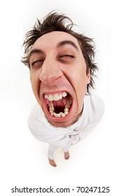 Fish eye shot of screaming insane man in strait-jacket in isolation