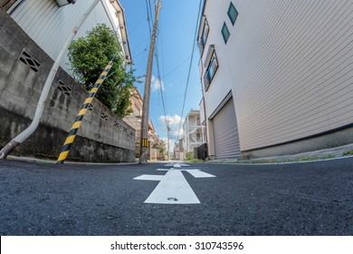 A fish eye shot taken from ground level on a small street in Japan.