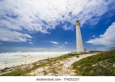 Fish eye view of Lighthouse on the shoreline; Rocky coastline; windy day at the beach; Rugged coastline