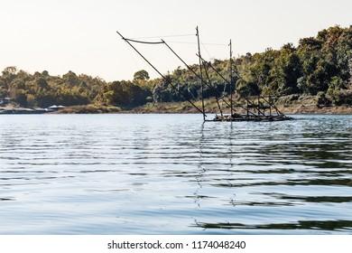 A fish farm or fishing structure on the river Kwai near the Vajiralongkorn Dam