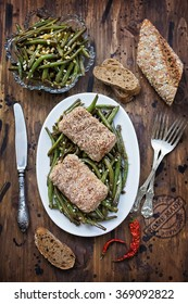 Fish fillet with almond crust with green beans