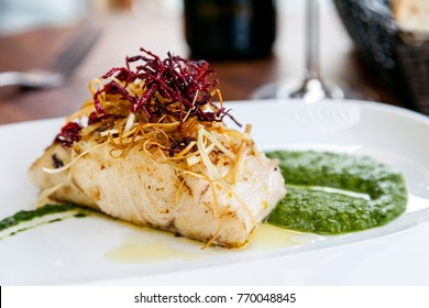 Fish Fillet with fried vegetables garnish and chutney
