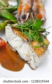 Fish fillet and lobster sauce on a plate