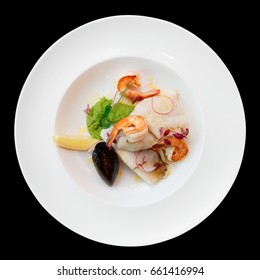Fish fillet with seafood, isolated on black background