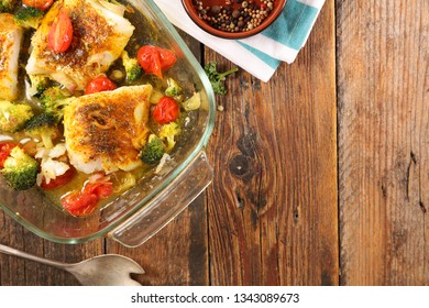 fish fillet with tomato and broccoli