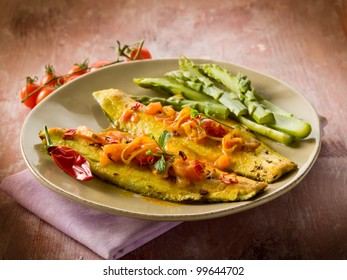fish fillet with tomato hot chili pepper and asparagus
