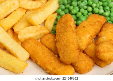 Fish fingers served with chips and peas.